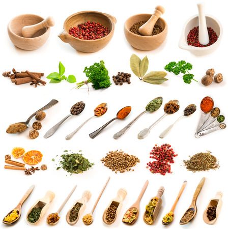 dry food: Collage of photos of different spices on spoons and dishes on a white background Stock Photo