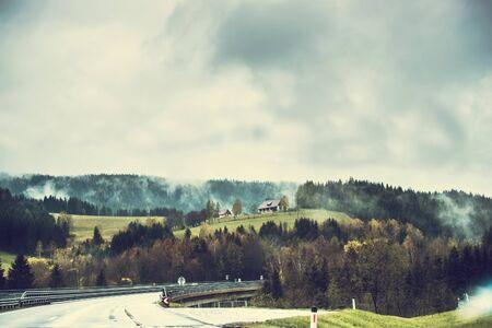 exhalation: Beautiful modern road  passing through the mountainous part of Austria Stock Photo
