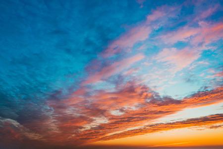 Fiery sunset sky. Beautiful clouds