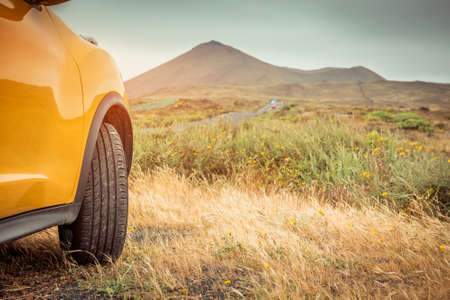 yellow car: Yellow car on a background of mountains