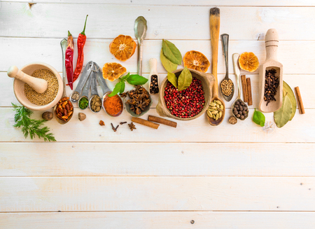 mortar: Collection of herbs and spices on a wooden background with space for text Stock Photo