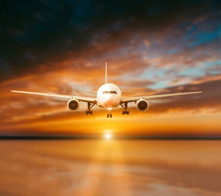 sunsets: plane lands on the runway on a background of gorgeous sunsets