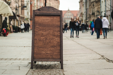 Cafe sign with space for text in an old European city