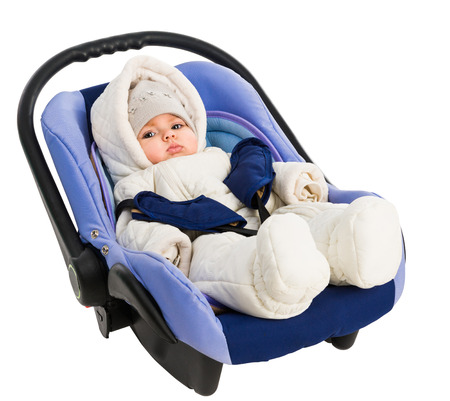 Six-month baby in a Car Seat, isolated on white photo