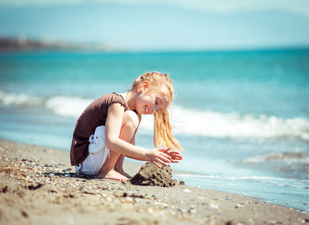 cute little girl run on tropical beach vacation Stock Photo - 39461607