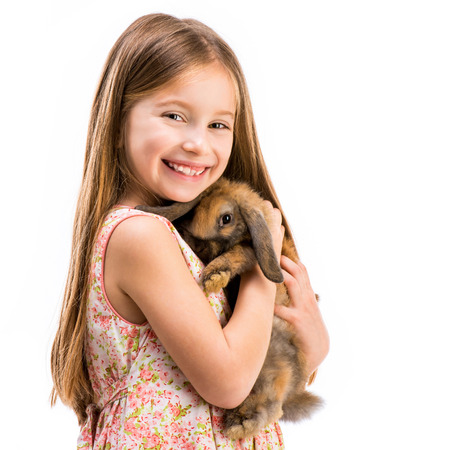 happy little girl with a rabbit Imagens