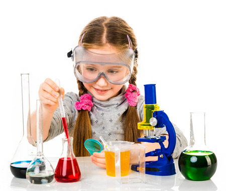 elementary age girl: happy little girl with flasks for chemistry isolated on a white background
