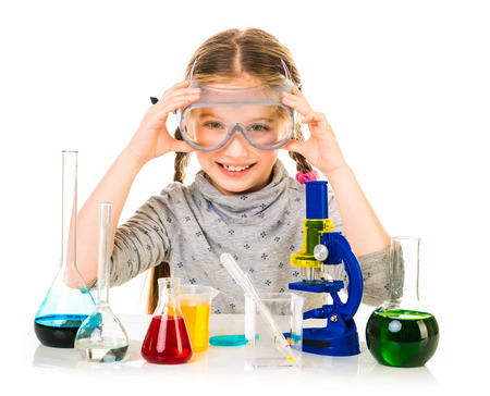 7 8 years: happy little girl with flasks for chemistry isolated on a white background