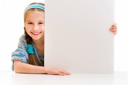 child holding sign: cute little girl holding a white board with space for text Stock Photo