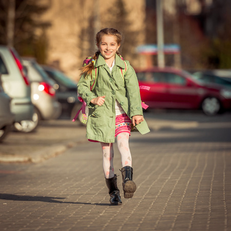8   9 years: happy little girl go home from school Stock Photo