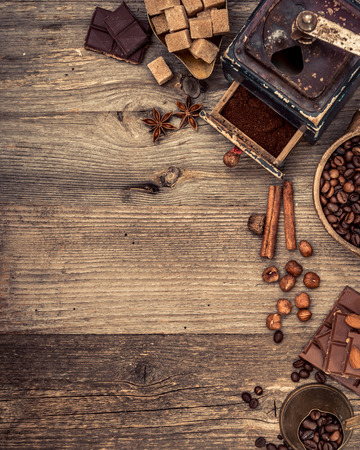 'retro styled': coffee beans and chocolate on a wooden background. top view