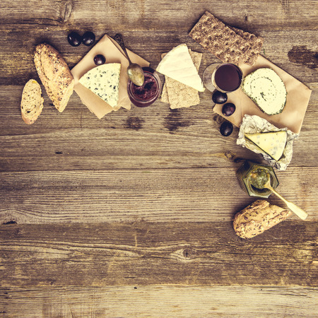 french text: French snacks on a wooden table with space for text
