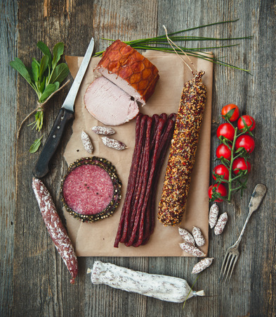 salami sausage: Assortment of cold meats over wooden background Stock Photo