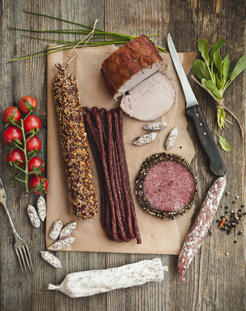 old fashioned vegetables: Assortment of cold meats over wooden background Stock Photo