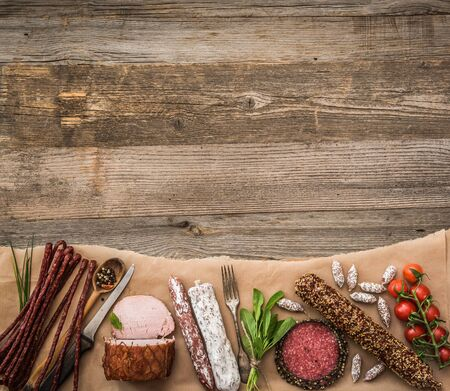 old fashioned vegetables: Assortment of cold meats over wooden background with space for text Stock Photo