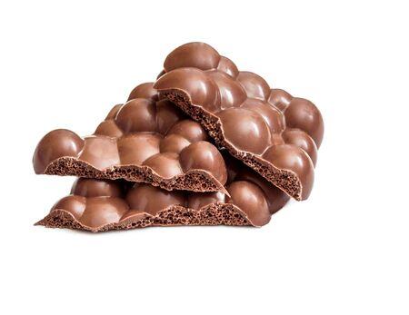 porous: Milk porous chocolate isolated on white background