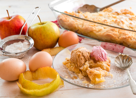 home made apple pie with ice cream on a wooden background photo