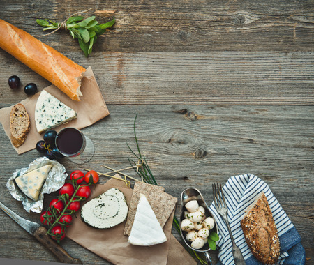 French snacks on a wooden table with space for text