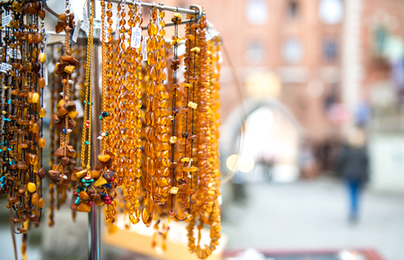 Amber beads for sale on an outdoor  in Gdansk. Poland Фото со стока