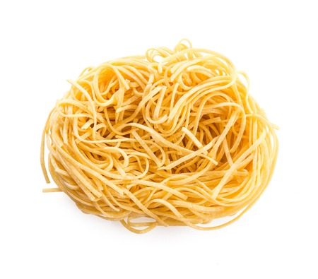 egg noodles: Raw egg noodles on a white background Stock Photo
