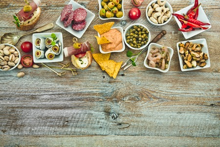 National Spanish tapas on a wooden background Archivio Fotografico