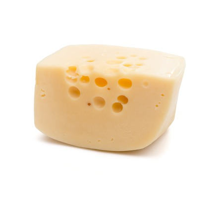 Isolated cheese chunk on white photo