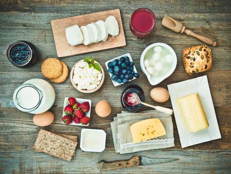 wooden table top view: Summer breakfast. fruit and dairy products on a wooden table. top view