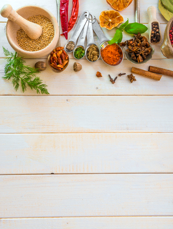 gastronomy: Collection of herbs and spices on a wooden background with space for text Stock Photo