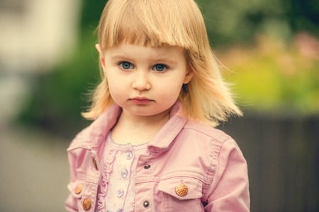 2 year old: Beautiful 2 year old girl in the street close up
