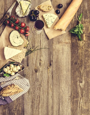 food and wine: French snacks on a wooden table with space for text
