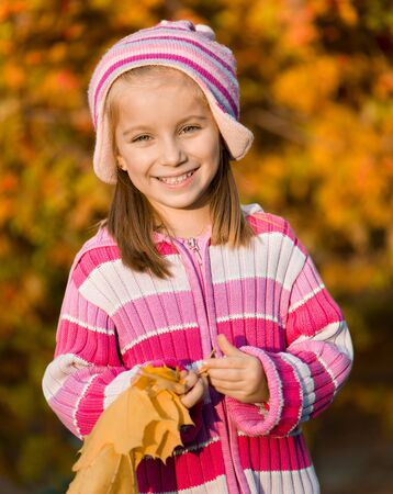 mountain ash: smiling  girl  against the leaves of mountain ash