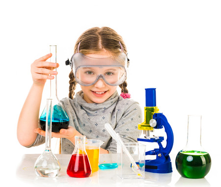 experiments: happy little girl with flasks for chemistry isolated on a white background