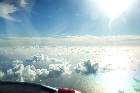 sky background: flying above the beautiful clouds in the sky