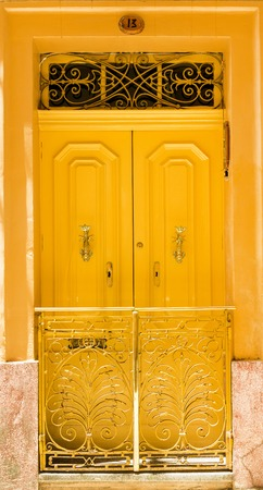 house series: colourful yellow front door to house Stock Photo
