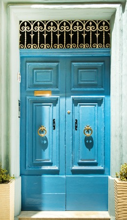 front house: colourful blue front door to house