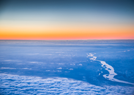 flying above the beautiful clouds in the evening sky Stock Photo