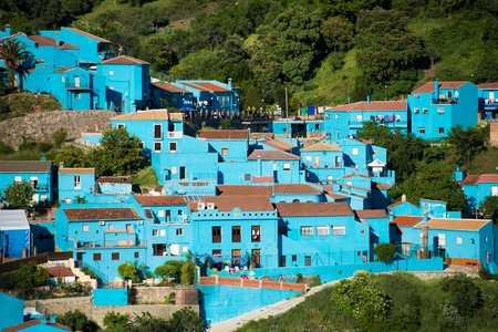 Juzcar, blue Andalusian village in Malaga, Spain. village was painted blue for The Smurfs movie launch Foto de archivo