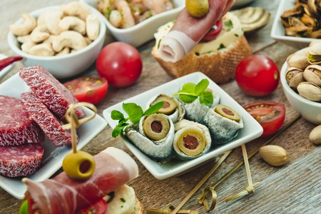 salted: National Spanish tapas on a wooden background Stock Photo