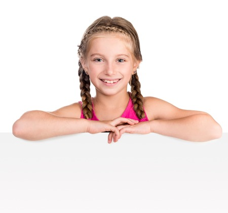 portrait studio: little smiling girl with white blank close up isolated on white background