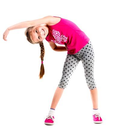 フィットネスをしている側の手で立っている女の子 写真素材