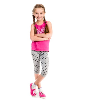 little girl child: little girl standing with hands on sides doing fitness