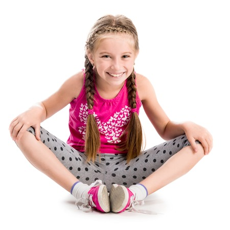 little girl doing yoga isolated on white background Stock Photo