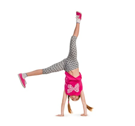 little girl turning handsprings in a studio
