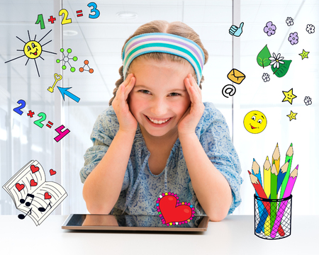 copybook: Happy little girl and her magic tablet Stock Photo
