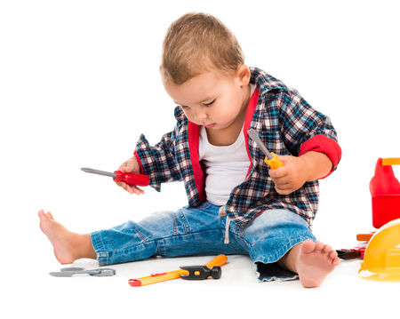 toys: little boy playing toy tools isolated on white background