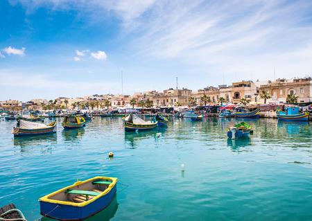 marina water: Fishing boats in Marsaxlokk harbor. Malta