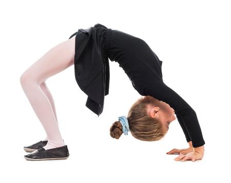 little girl doing the exercise bridge isolated on white background