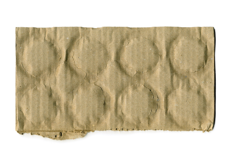 teared paper: Brown corrugated cardboard torn isolated on white background with place for text