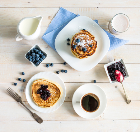 pancakes with blueberry and coffee on wooden background. top view Stockfoto