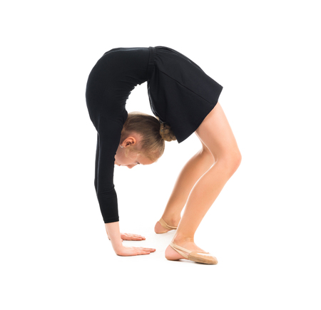 limber: little gymnast stretching on the floor isolated on white background
